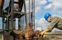 BLACK GOLD, RED SLIP: Tumbling crude oil prices could take thousands of workers and a few state budgets down with it.