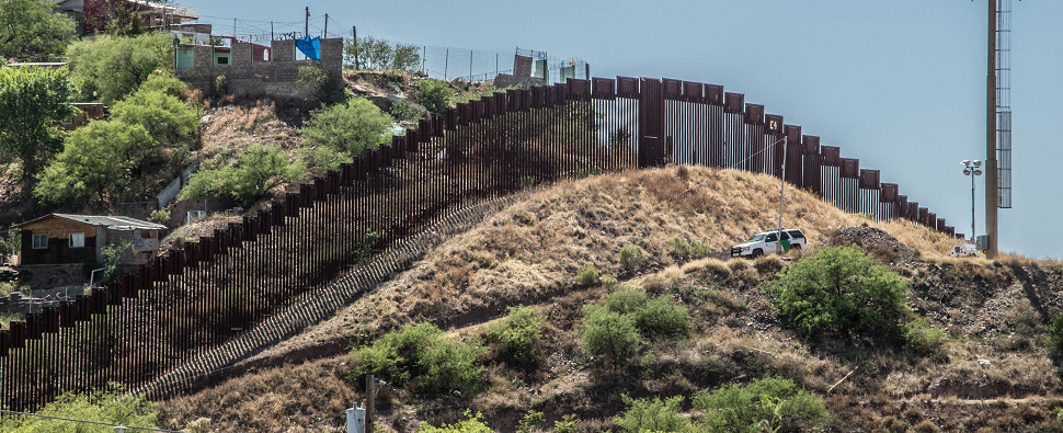 Trump's insistence on building border wall may be connected to his policy with Mexico regarding shipments of export cargo and import cargo in international trade.