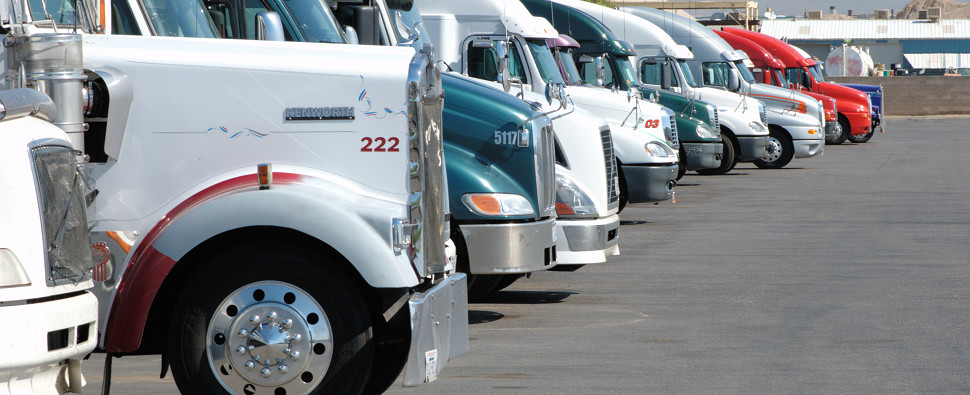 Trucks carry shipments of export cargo and import cargo in international trade.