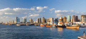 Ships in port along Dubai's skyline