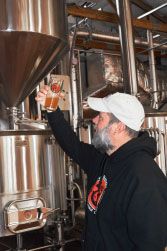 """THIS GLASS IS HALF FULL! Tim Cochran of Horse & Dragon Brewing Co. says, """"People are very interested in craft beer, especially in countries where there is not a strong craft beer scene."""""""