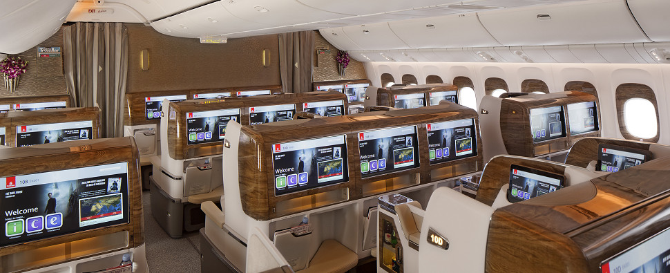 Business class versus first class travel for executives of companies with shipments of export cargo and import cargo in international trade.